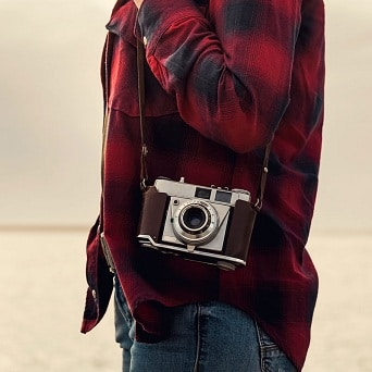 Image of woman carrying a camera