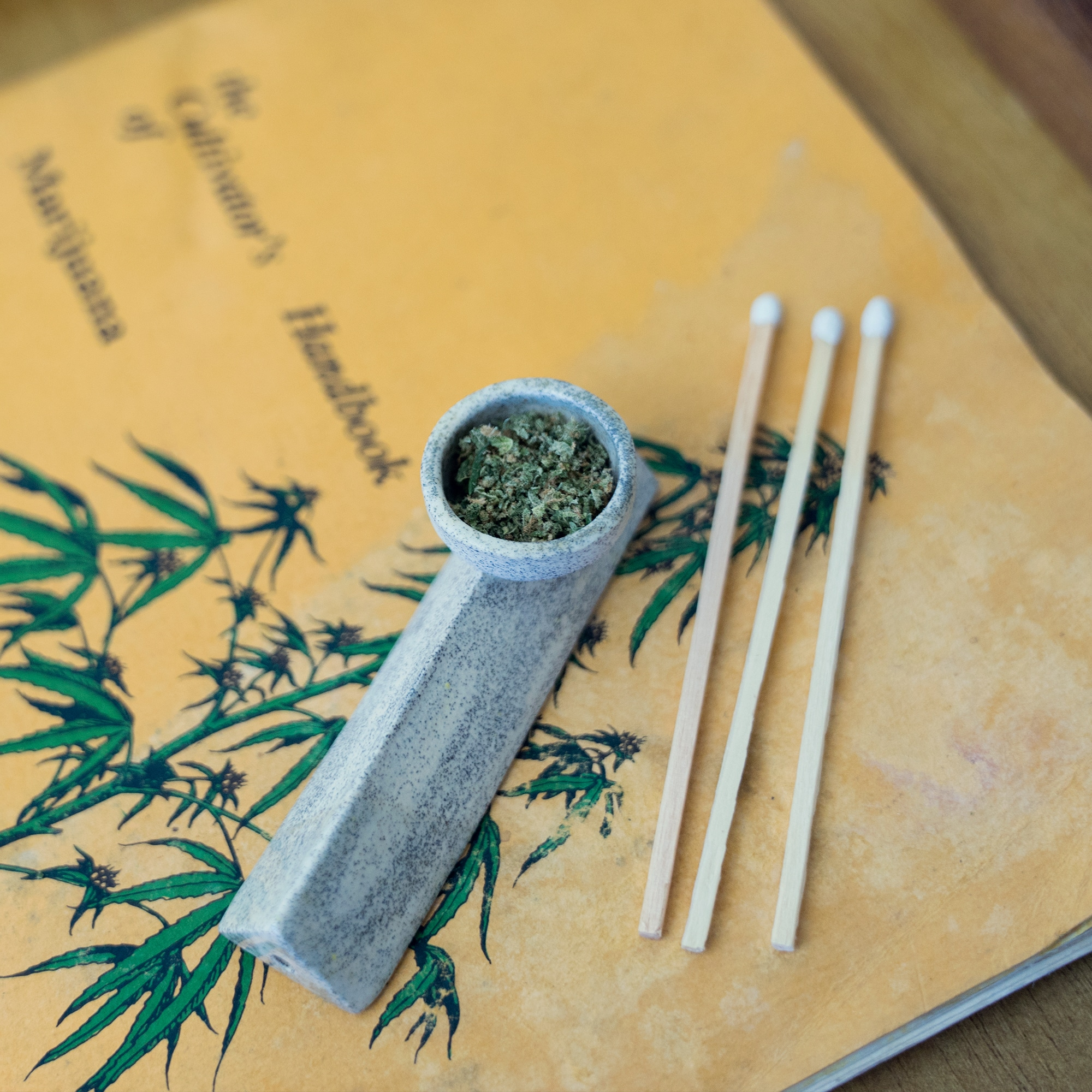 Close up image of Cannabis pipe and matches