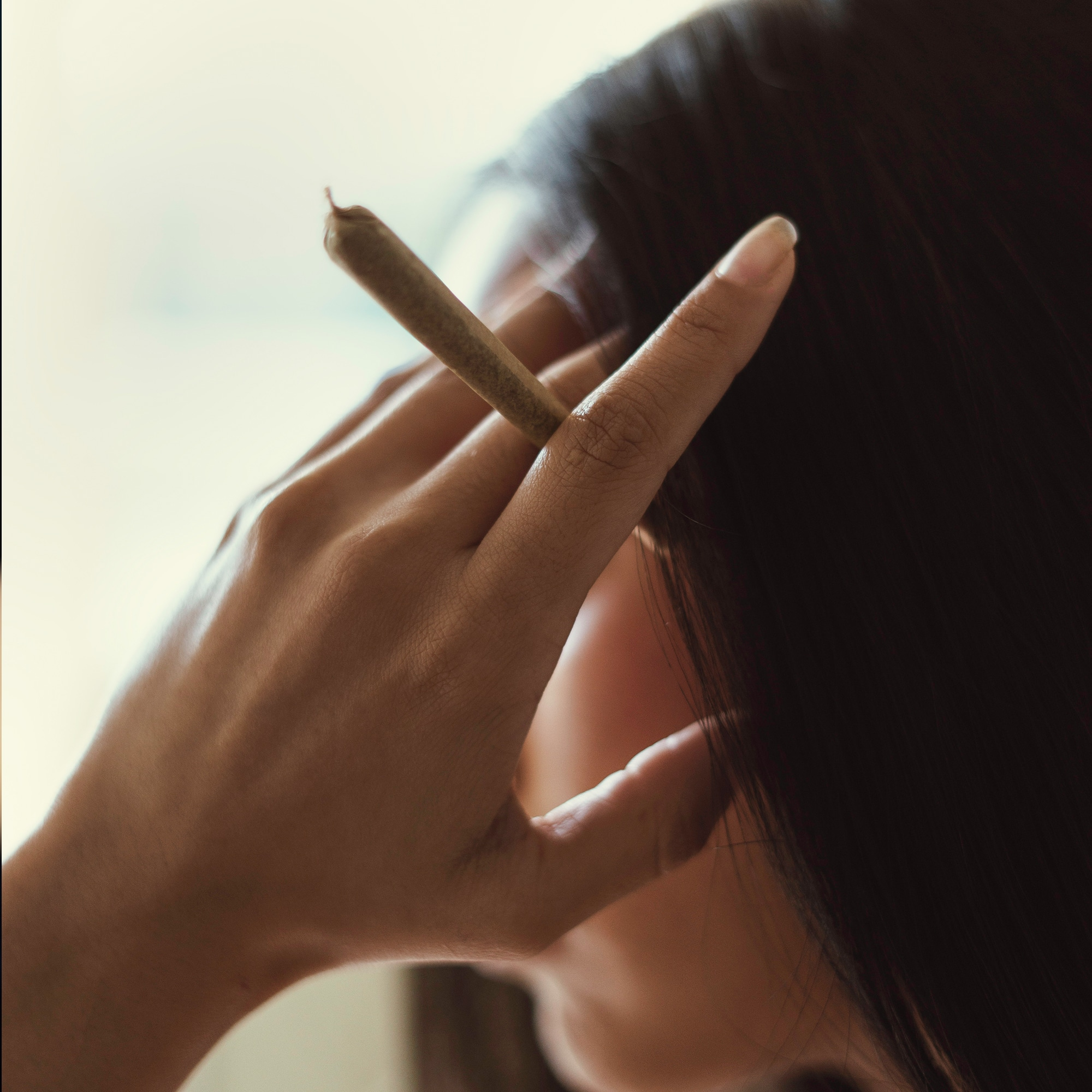 Image of woman holding a joint
